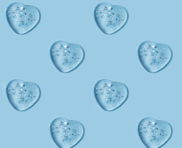 Cosmetics gel smears looks like heartpatternclean blue background with copy space