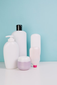 Cosmetics jar near bottles