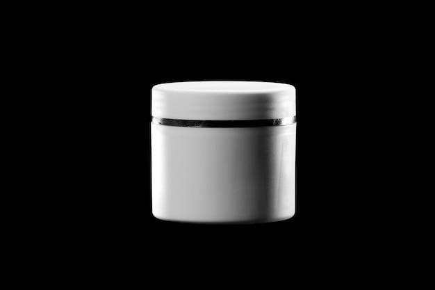 Cosmetics, moisturizer, bottle. cosmetic jar isolated on black background. cosmetic package for cream, soaps, foams, shampoo.