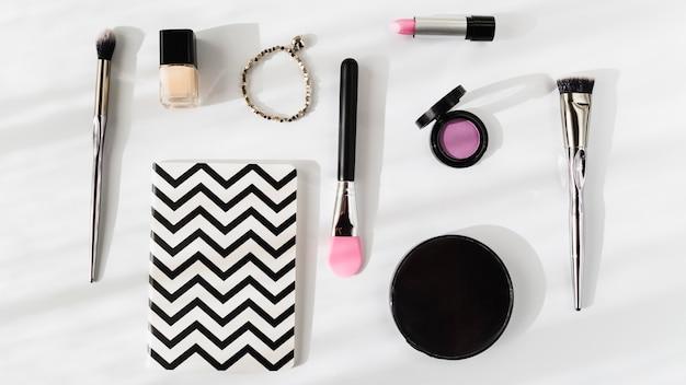 Cosmetics near lovely notebook
