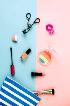 Cosmetics near striped makeup bag
