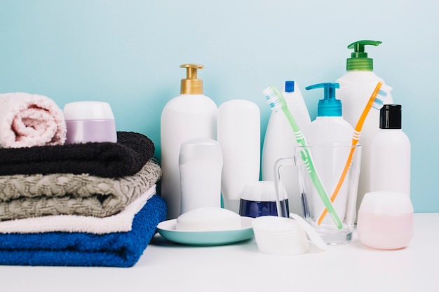 Cosmetics near towels and toothbrushes