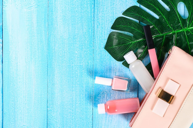 Cosmetics in a pink cosmetic bag.