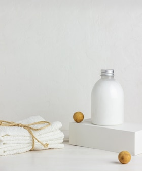 Cosmetics and towels on a white background. design. minimal concept.