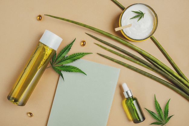 Cosmetics with hemp cbd oil on a beige