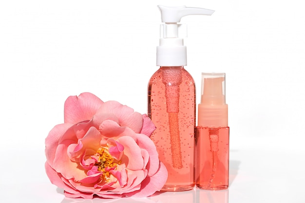 Cosmetics with rose extract. gel and tonic pink color with rose extract in a plastic bottle and terry big pink flower rose