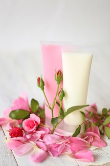 Cosmetics with rose extract.  gel for washing with rose extract and rose petals on  shabby chic .
