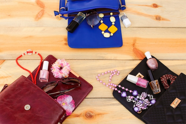 Cosmetics and women's accessories fell out of different handbag