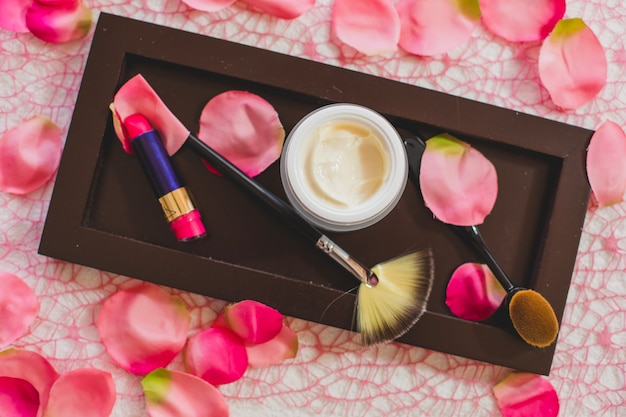 Cosmetics on wooden board