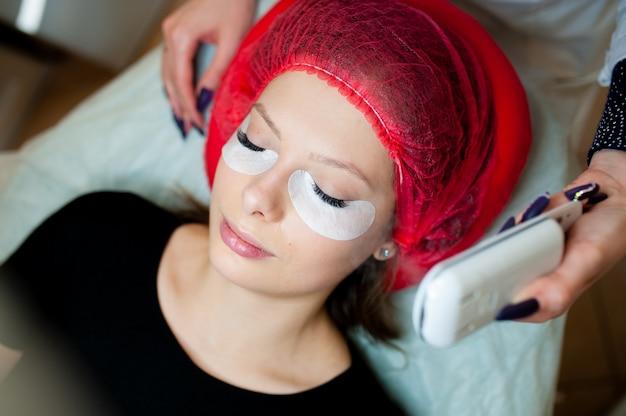 Cosmetologist makes beauty treatment