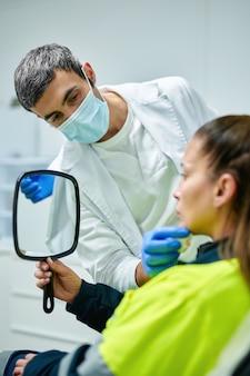 Cosmetologist making botox injection