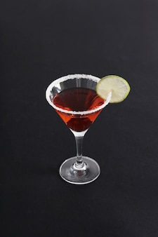 Cosmopolitan cocktail with lemon slice