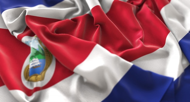 Costa rica flag ruffled beautifully waving macro close-up shot