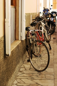 Cosy european street with bicycles and bikes parking