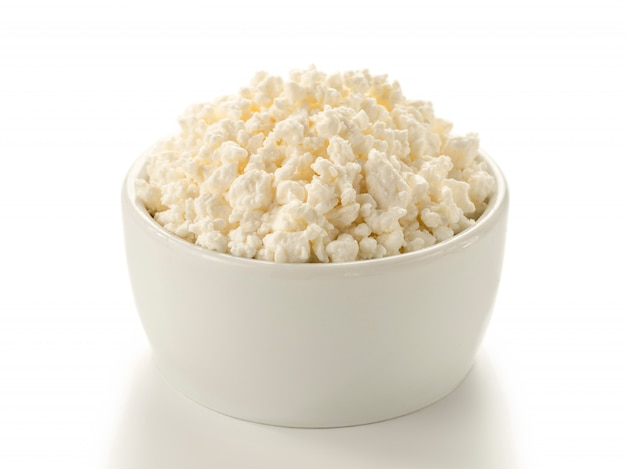 Cottage cheese in bowl isolated
