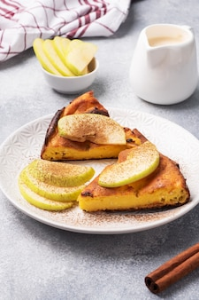 Cottage cheese casserole with apples and cinnamon spices. concept of a healthy breakfast.