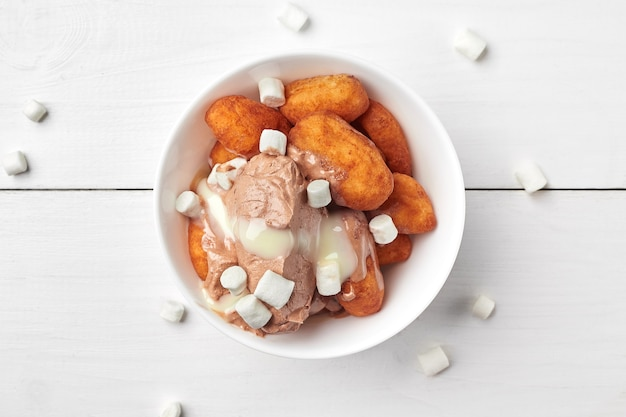 Cottage cheese croquettes with chocolate ice cream and marshmallow