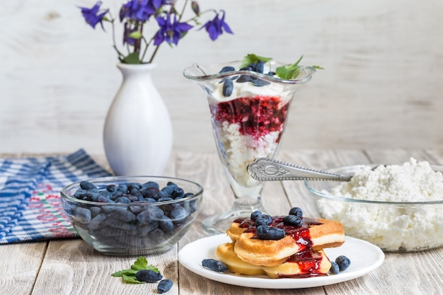 Cottage cheese dessert and berry on wooden table
