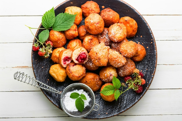 Cottage cheese donuts with raspberries