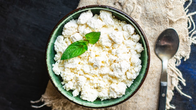 Cottage cheese fresh healthy food breakfast cow or goat sheeps milk on the table healthy food
