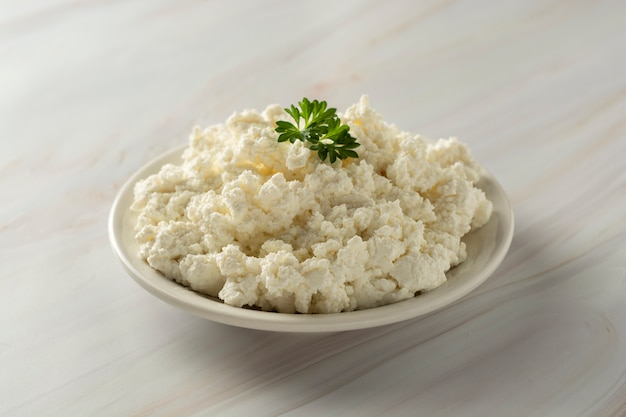 Cottage cheese on marble background. dairy products, calcium and protein.