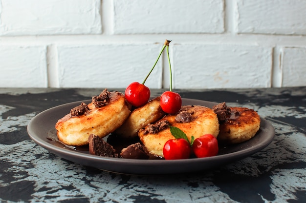 Cottage cheese pancakes with cherries and chocolate