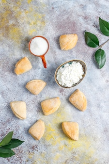 Cottage cheese and sugar cookies crows feet triangle cookies, top view