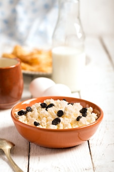 Cottage cheese with raisins and eggs. vertical orientation