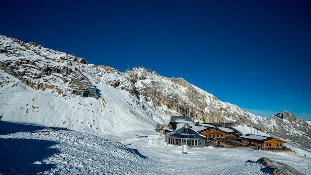 Cottage house snow landscape