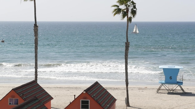 Cottages in oceanside california usa. beachfront bungalows. ocean beach palm trees. lifeguard tower.