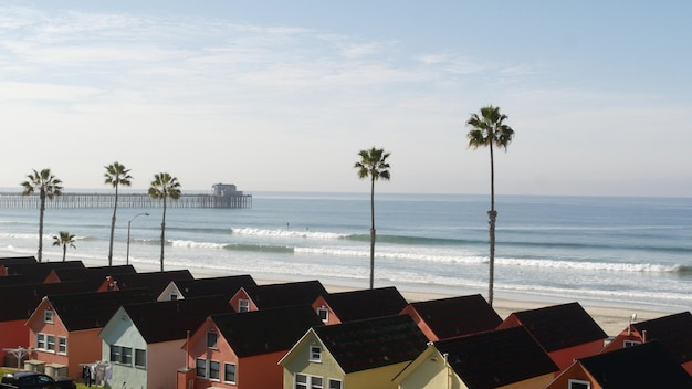 Cottages in oceanside california usa. beachfront bungalows. ocean beach palm trees. summer seascape.