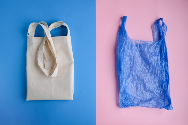 Cotton bag and plastic bag on pink and blue