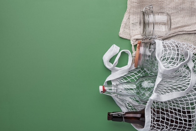 Cotton bags, glass bottles and jar.