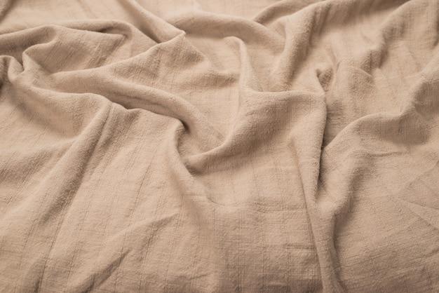 Хлопковая бежевая ткань узор фона