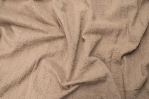Хлопковая ткань бежевого цвета.