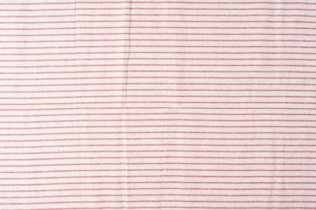 빨간색과 흰색 줄무늬의 면 직물 패브릭 질감 빨간색과 흰색 줄무늬의 클로즈업