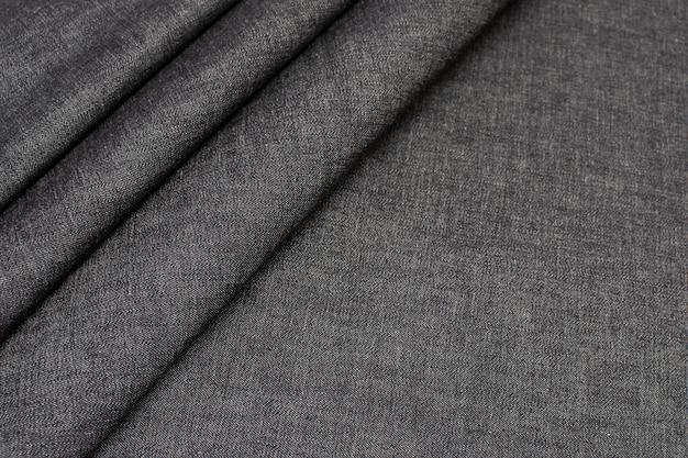 綿織物。ジーンズ。黒い色。テクスチャー、
