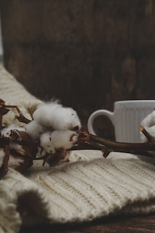 Cotton flowers on wooden table