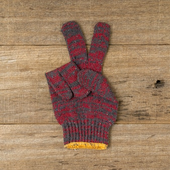 Cotton glove show a peace sign.