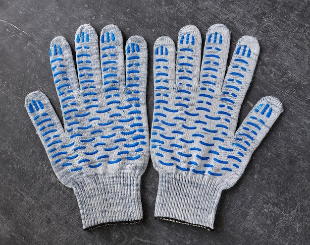 Cotton gloves with blue rubber studs