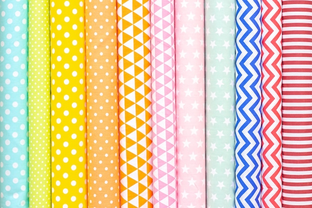 Cotton light tones fabric texture. pink, orange, yellow, turquoise colors