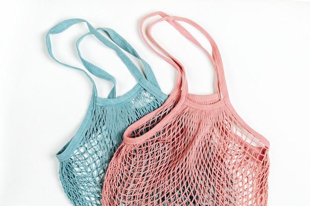 Cotton net bag on white background. zero waste concept. sustainable lifestyle.