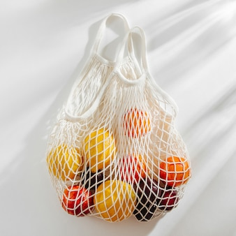 Cotton net bag with fruits. sustainable lifestyle.  eco friendly concept.