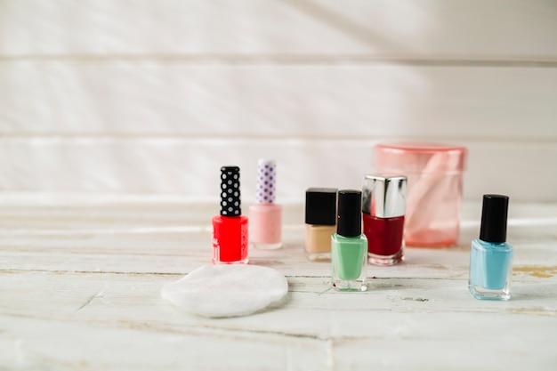 Cotton pad near nail polishes
