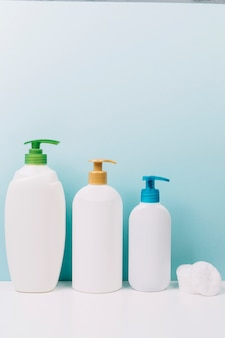 Cotton pads near cosmetics bottles