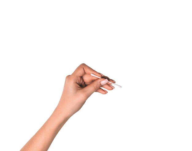 Cotton swab in hand on an isolated background