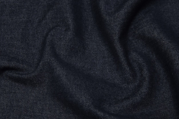 Cotton or wool fabric denim. dark gray or black color. texture, background, pattern.