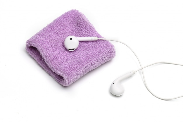 Cotton wrist band and earphone on white background