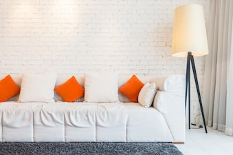 Couch with cushions and floor lamp