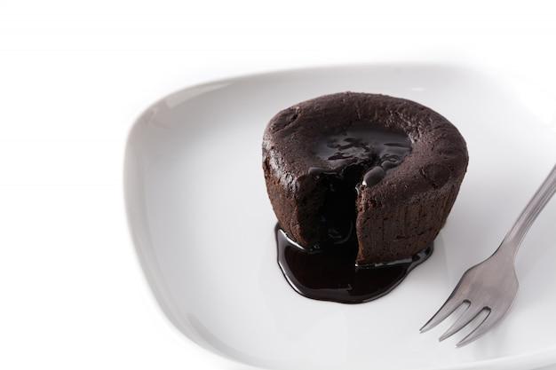 Coulant chocolate cake isolated on white